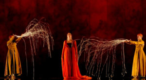 Erin Wall as Clémence (centre) and acrobats Antoine Marc and Ted Sikström (back, left to right) in a scene from the Canadian Opera Company production of Love from Afar, 2012. Conductor Johannes Debus, original production by Daniele Finzi Pasca, set designer Jean Rabasse, costume designer Kevin Pollard, and lighting designers Daniele Finzi Pasca and Alexis Bowles. Photo: Chris Hutcheson